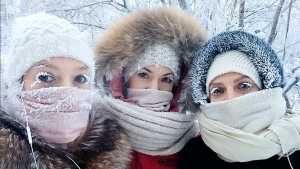 In this photo taken on Sunday, Jan. 14, 2018, Anastasia Gruzdeva, left, poses for selfie with her friends as the temperature dropped to about -50 degrees in Yakutsk, Russia. (sakhalife.ru photo via AP)