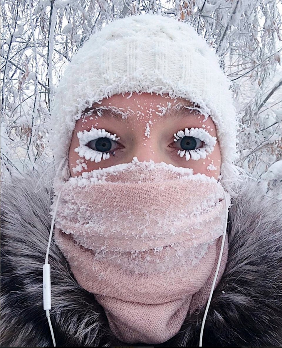 In this photo taken on Sunday, Jan. 14, 2018, Anastasia Gruzdeva poses for selfie as the Temperature dropped to about -50 degrees in Yakutsk, Russia. (sakhalife.ru photo via AP)