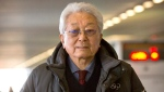 North Korea's IOC representative Chang Ung arrives after a flight from Pyongyang at Beijing Capital International Airport in Beijing, Tuesday, Jan. 16, 2018. (AP Photo/Mark Schiefelbein)