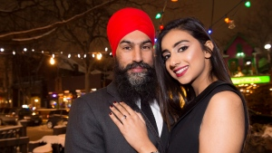 NDP Leader Jagmeet Singh poses with Gurkiran Kaur after proposing to her at an engagement party in Toronto, Tuesday January 16, 2018. THE CANADIAN PRESS/Frank Gunn