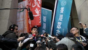 Pro-democracy young activist Joshua Wong talks to reporters in front of the Court of Final Appeal Hong Kong, Tuesday, Jan. 16, 2018. (Vincent Yu/AP Photo)