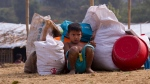 """A Rohingya boy sits guarding his family belongings as they prepare to erect a makeshift tent at Nayapara refugee camp, some 69 kilometres (43 miles) from in Cox bazar, Bangladesh, Saturday, Jan. 13, 2018. In the Rakhine state of Myanmar, government troops have been accused of """"ethnic cleansing"""" that has forced more than 655,000 of Rohingya Muslims to flee into Bangladesh, out of which 60 per cent of the refugees are children. (AP Photo/Manish Swarup)"""