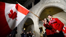 Canadian figure skaters Tessa Virtue and ScottMoir are announced as Canada's flag bearers during an event in Ottawa, Ont., on Tuesday, Jan. 16, 2018. Virtue and Moir will represent Canada during the opening ceremonies of the PyeongChang Olympic Games. THE CANADIAN PRESS/Sean Kilpatrick