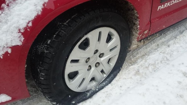 "All four tires on the Parkdale Food Centre's ""Reverse Food Truck"" were found slashed on Tuesday morning, Jan. 17, 2018. (@ParkdaleFood/Twitter)"