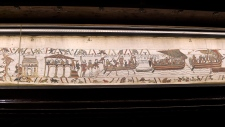 This undated image provided by the Mairie de Bayeux (Bayeux city hall), Normandy, France, shows a section from the Bayeux Tapestry. F(Stephane Maurice/Mairie de Bayeux via AP)