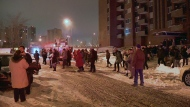 About 200 residents of a highrise apartment building spent the night in the cold after a fire broke out in an electrical room (CTV Montreal/Cosmo Santamaria)