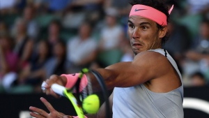 Rafael Nadal makes a forehand return at the Australian Open, on Jan. 17, 2018. (Andy Brownbill / AP)