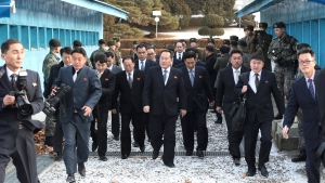 In this Tuesday, Jan. 9, file photo, the head of the North Korean delegation Ri Son Gwon, centre, arrives at the South side for the meeting with South Korea at Panmunjom in the Demilitarized Zone in Paju, South Korea. (Korea Pool/Yonhap via AP)