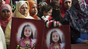 Protesters hold posters featuring Zainab Ansari, in Lahore, Pakistan, on Jan. 13, 2018. (K.M. Chaudary / AP)