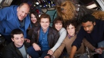 Solo: A Star War story cast pose for a photo, from bottom left, co-director Christopher Miller, Woody Harrelson, Phoebe Waller-Bridge, Alden Ehrenreich, Emilia Clarke, Joonas Suotamo as Chewbacca, co-director Phil Lord and Donald Glover. (Jonathan Olley/Lucasfilm via AP)
