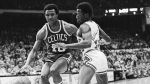 In this Dec. 30, 1977 file photo, Jo Jo White, left, of Boston Celtics, drives past Chicago Bulls' Wilbur Holland (12) during an NBA basketball game in Chicago. (AP /Fred Jewell)