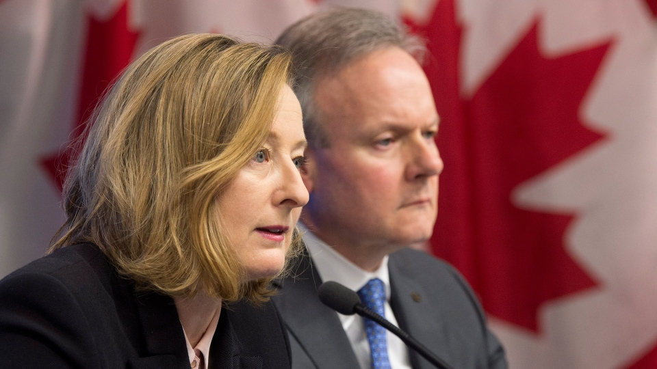Bank of Canada Senior Deputy Governor Carolyn Wilkins reads the opening statements as Bank of Canada Governor Stephen Poloz looks on during a news conference in Ottawa, Wednesday, Jan. 17, 2018. (Adrian Wyld / THE CANADIAN PRESS)