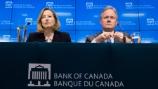 Bank of Canada Senior Deputy Governor Carolyn Wilkins and Bank of Canada Governor Stephen Poloz listen to a question during a news conference in Ottawa, Wednesday Jan. 17, 2018. (THE CANADIAN PRESS/Adrian Wyld)