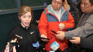 In this Tuesday, Jan. 16, 2018, photo, South Korean women's hockey team head coach Sarah Murray speaks as she returns from the team's U.S. training camp, at Incehon International Airport in Incheon, South Korea. (Ha Sa-hun/Yonhap via AP)
