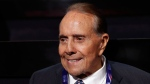 FILE - In this July 18, 2016 file photo, former Republican presidential candidate Sen. Bob Dole arrives at the Republican National Convention in Cleveland. The New York Times is reporting that last week's telephone call between President-elect Donald Trump and Taiwan's president was the result of six months of behind-the-scenes work by Dole acting on behalf of the Taiwanese government. (AP Photo/Carolyn Kaster, File)