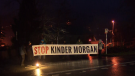 Protesters block the entrance to Kinder Morgan's Westridge Marine Terminal before sunrise on Jan. 17, 2018.