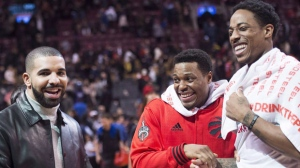 Toronto Raptors guards Kyle Lowry, centre, and DeMar DeRozan, right, share a laugh with rapper Drake after defeating the Philadelphia 76ers in NBA basketball action in Toronto on Tuesday, April 12, 2016. The Raptors and Canadian rap star Drake announced plans to grow their partnership Wednesday with a new program called Welcome Toronto. THE CANADIAN PRESS/Nathan Denette