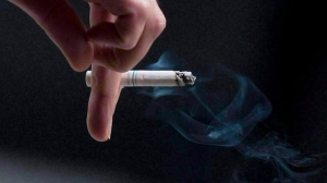 A person smokes a cigarette in this file photo from Sept. 29, 2009. (Pawel Dwulit /The Canadian Press)