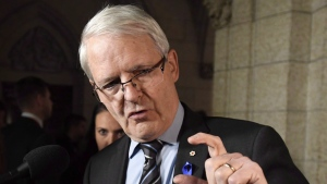 Minister of Transport Marc Garneau gestures as he speaks to reporters following Question Period in the Foyer of the House of Commons on Parliament Hill in Ottawa on Monday, Nov. 20, 2017. (THE CANADIAN PRESS / Justin Tang)