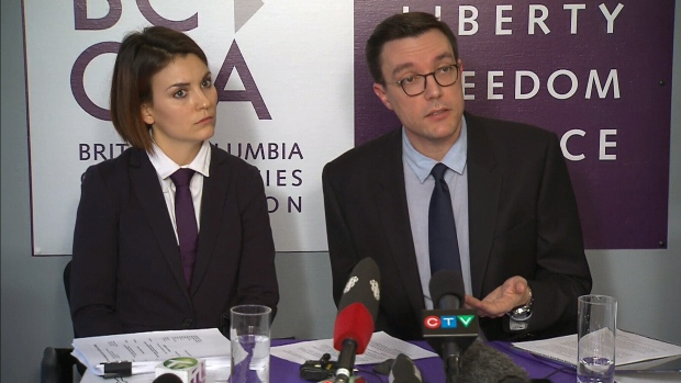 B. C. Civil Liberties Association staff lawyer Jay Aubrey and executive director Josh Paterson speak to reporters on Wednesday, Jan. 17, 2018.