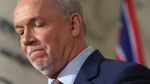 Premier John Horgan is joined by Minister of Energy Michelle Mungall and Minister of Environment George Heyman after giving the green light on continuing construction on the controversial Site C Dam project during a press conference in Victoria, B.C., on Monday, December 11, 2017. THE CANADIAN PRESS/Chad Hipolito