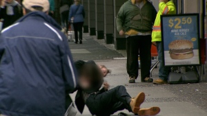 A scuffle breaks out between a pot vendor and another man near Robson Square's illegal pot market. (CTV)
