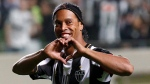 In this July 11, 2013 file photo, Brazil's Atletico Mineiro's Ronaldinho celebrates his team's victory over Argentina's Newell's Old Boys at the end of a Copa Libertadores semifinal soccer match in Belo Horizonte, Brazil. (AP Photo / Bruno Magalhaes, File)