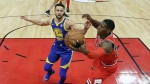 Chicago Bulls' Kris Dunn grabs a rebound over Golden State Warriors' Stephen Curry during the first half of an NBA basketball game in Chicago on Wednesday, Jan. 17, 2018. (AP Photo/Charles Rex Arbogast)