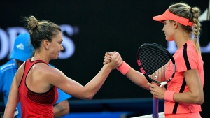 Romania's Simona Halep, left, shakes hands with Canada's Eugenie Bouchard as Halep won their second round match at the Australian Open tennis championships in Melbourne, Australia, Thursday, Jan. 18, 2018. (AP /Andy Brownbill)