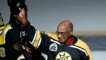 Former Boston Bruins wing Willie O'Ree tips his hat as he is honoured prior to the first period of an NHL hockey game against the Montreal Canadiens in Boston, Wednesday, Jan. 17, 2018. O'Ree broke the NHL's color barrier 60 years ago while playing a game against the Canadiens in 1958. (AP Photo/Charles Krupa)