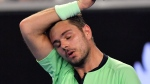 Switzerland's Stan Wawrinka wipes the sweat from his face during his second round match against United States' Tennys Sandgren at the Australian Open tennis championships in Melbourne, Australia, Thursday, Jan. 18, 2018. (AP /Andy Brownbill)