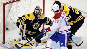 Boston Bruins goaltender Tuukka Rask (40) drops to his pads as a deflected shot by Montreal Canadiens defenseman Jakub Jerabek hits the back of the net for a goal during the first period of an NHL hockey game in Boston, Wednesday, Jan. 17, 2018.  (AP Photo/Charles Krupa)