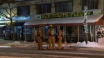 Montreal firefighters stand in front of a Fleury St. greengrocer where a fire broke out Thursday Jan. 18, 2018 (CTV Montreal/Cosmo Santamaria)