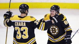 Boston Bruins right wing David Pastrnak, right, celebrates scoring on Canadiens Carey Price with defenceman Zdeno Chara in Boston, Wednesday, Jan. 17, 2018. (AP Photo/Charles Krupa)