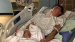 Landon Smith in hospital shortly after an incident at a Sherwood Park trampoline park.