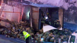 Firefighters emptied the cargo of a truck that caught fire on Highway 25 in order to make sure nothing else was burning (CTV Montreal/Jan. 18, 2018)