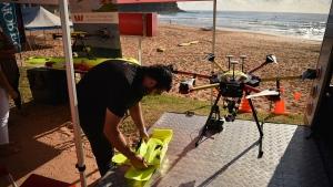 Drone pilot Ben Trollope setting up his shark-spotting drone on Bilgola beach north of Sydney. (Peter Parks / AFP)