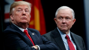 In this Dec. 15, 2017 file photo, President Donald Trump, left, sits with Attorney General Jeff Sessions during the FBI National Academy graduation ceremony in Quantico, Va. (AP / Evan Vucci)