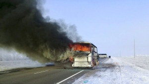 A bus burns on a road in near the village of Kalybai in Kazakhstan, on Jan. 18, 2018. (Kazakhstan Ministry for Emergency Situations via AP)