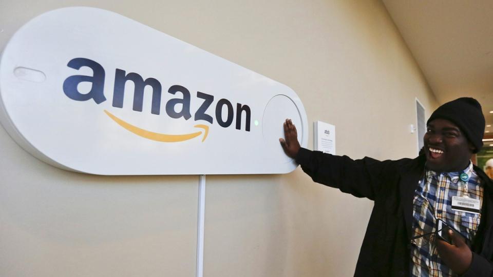 Zavian Tate pushes a large Amazon Dash button in Birmingham, Ala., on Oct. 16, 2017. (Brynn Anderson / AP)