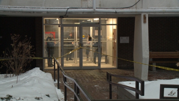 Police tape surrounds the entrance to 125 Mcleod Street in Ottawa where a police investigation is taking place in relation to a fatal shooting on Thursday, Jan. 18, 2018.