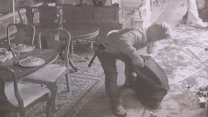 Surveillance photo shows a suspect collecting jewelry at Roadshow's 400 Antique Mall in Innisfil, Ont. (CTV Barrie)