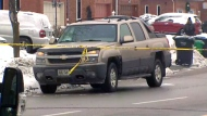 Police tape blocks off a pick-up truck believed to be involved in a fatal pedestrian collision in Brampton on Dec. 18, 2018.