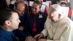 Pope Francis marries flight attendants Carlos Ciuffardi, left, and Paola Podest, center, during a flight from Santiago, Chile, to Iquique, Chile, Thursday, Jan. 18, 2018. (L'Osservatore Romano Vatican Media/Pool Photo via AP)