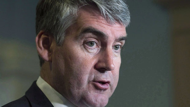 Nova Scotia Premier Stephen McNeil talks with reporters at the legislature in Halifax on Wednesday, May 31, 2017. (THE CANADIAN PRESS / Andrew Vaughan)