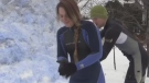 Alisha and Joey Postma build huge snow sculpture