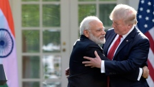 Trump, hug