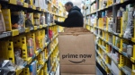 In this Wednesday, Dec. 20, 2017, file photo, a clerk reaches to a shelf to pick an item for a customer order at the Amazon Prime warehouse, in New York. (AP Photo / Mark Lennihan, File)