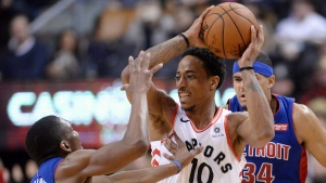 Toronto Raptors guard DeMar DeRozan (10) looks to pass the ball under pressure from Detroit Pistons guard Langston Galloway (9) and forward Tobias Harris (34) during second half NBA basketball action in Toronto on Wednesday, January 17, 2018. (Frank Gunn/THE CANADIAN PRESS)