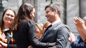 New Zealand's Prime Minister Jacinda Ardern, center left, embraces her partner Clarke Gayford after speaking to well-wishers in front of the parliament on Thursday, Oct. 26, 2017, in Wellington, New Zealand. (Nick Perry/AP Photo)